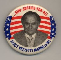 Image of Political button: ...And Justice for All. Elect Vezzetti Mayor in '85.