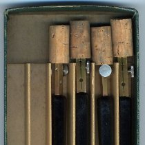 Image of pens as found in box tray with cork protectors