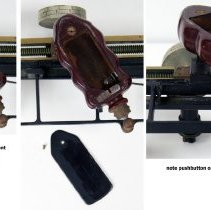 Image of wood handle with battery compartment, cover & pushbutton control
