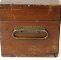 Image of side view of case with handle; note molded bead on lid edge