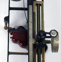 Image of detail of left side, front end; magnifier in place