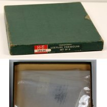 Image of box with printed label; contents in pocket storage sleeve, folded