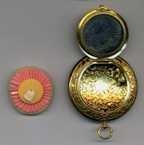 Image of view open with powder puff removed; note mirror condition