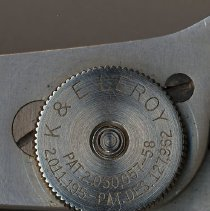 Image of detail of knob with name and patent dates