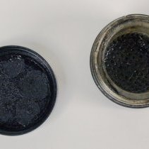 Image of jar open with inserted sieve (strainer)