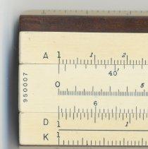 Image of slide inverted, left end: scales & serial number; slide scales at other end