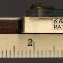 Image of detail lower edge, left end & markings on indicator