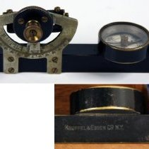 Image of left side view with detail of maker's mark below compass