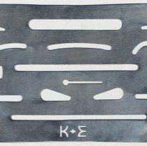 Image of Erasing shield, stamped metal with K&E logo. Made by Keuffel & Esser Co., n.d., ca. 1950-1960. - Shield, Erasing