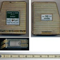 Image of several views of K&E LST 90th Anniversary keepsake tape measure