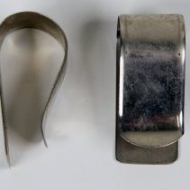 Image of two paper spring clips or clamps.