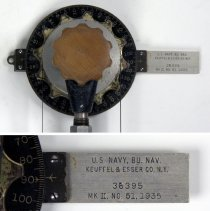 Image of protractor head with marked blade for scale; detail of markings