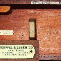 Image of detail inside lid with K&E plate and model number scribed to right