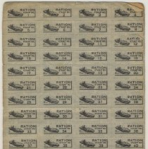 Image of typical full sheets of coupons or stamps; boat or tank motif