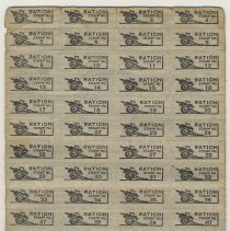 Image of typical full sheet of coupons or stamps with artillery motif