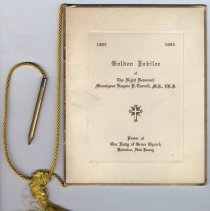 Image of view of front cover with cord, pencil & tassel