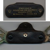 Image of top: front view with lettering; bottom: back, opened with keys outs