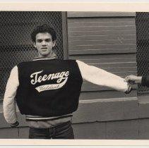 Image of front: Frank Nunez holding jacket