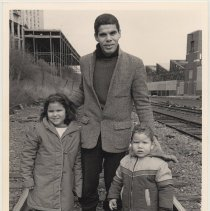 Image of B+W photo of William Dejusus with his children walking on west side tracks ca. 16-17th Sts. , Hoboken, n.d, ca. 1983-1988. - Print, Photographic