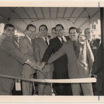 Image of B+W photo of a ribbon cutting at K of C housing, Bloomfield St., Hoboken, n.d, ca. 1983-1988. - Print, Photographic