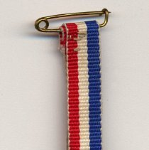 Image of medal with ribbon as received