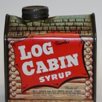 Image of front view Log Cabin Syrup tin with Hoboken location