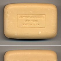 Image of typical bar or cake unwrapped, both sides shown