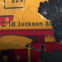 Image of closer detail, rotated, of label left side with Hoboken street address