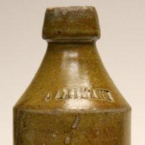 Image of Bottle: J. Axtmann; embossed glazed stoneware. Hoboken, n.d., ca. 1860-1880. - Bottle