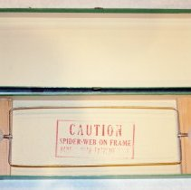 Image of box interior with wire frame in stored position
