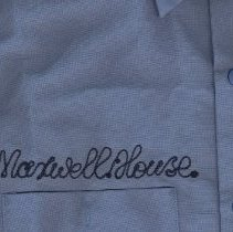 Image of detail shirt 1 with embroidered lettering