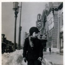 Image of B+W photo of George A. Tompkins, Jr., ca. 5-7 years of age, shoveling snow near U.S. Theatre, Hoboken, winter, 1940. - Print, Photographic