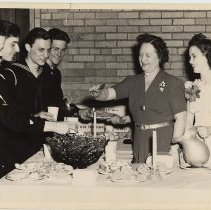 Image of B+W photo of women serving punch to Coast Guard members at Hoboken Y.M.C.A. dance, Hoboken, n.d., ca. 1942-1945. - Print, Photographic