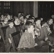 Image of B+W photo of boys seated for program at Hoboken YMCA, Hoboken, n.d. ca, 1942-1945. - Print, Photographic