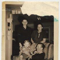 Image of B+W photo Eileen (Smith) Thiel, Helen Smith, Billy Thiel & Bridget Roarty in 15 Willow Terrace, Hoboken, n.d., ca. 1948. - Photograph