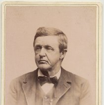 Image of Cabinet photo of middle aged man posed in photo studio, Hoboken, n.d., ca. 1885-1892.  - Photograph, Cabinet