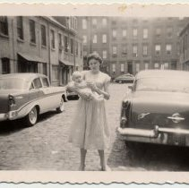Image of B+W photo of Joan Cunning holding Edward Cunning, Jr. in Willow Terrace South, Hoboken, 1957. - Photograph