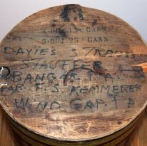 Image of wood lid with stenciled contents & handwritten destination