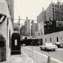 Image of B+W photo of Holland Tunnel N.Y. entry portal with Holland bust & bunting for 50th anniversary, Nov. 11, 1977. - Print, Photographic