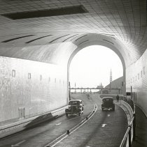 Image of Lantern slide: New Jersey. Lincoln Tunnel: Looking out of Tunnel at Western Portal. (1938).  - Transparency, Lantern Slide