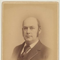 Image of Sepia-tone photo of an unidentified balding man posed in photographer's studio, Hoboken, n.d., ca. 1892-1894. - Photograph, Cabinet