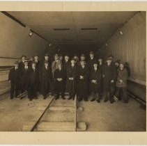 Image of Sepia-tone group photo of tunnel commission members & other staff inspecting Holland Tunnel tile, lighting & railing samples, N.Y., Feb. 10, 1925. - Photograph