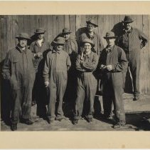 Image of Sepia-tone group photo of eight Holland Tunnel workers, n.p., n.d., ca. 1923-1925.  - Photograph