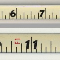 Image of details of tape; measurement by foot and inches