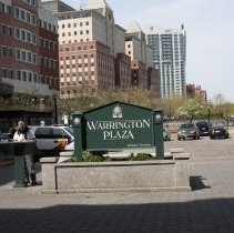 Image of 051 view north of Warrington Plaza sign and bronze plaque on pedestal