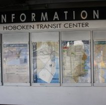 Image of 040 information sign, Hoboken Transit Center, under scaffold east of 039