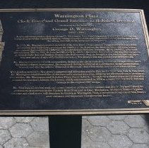 Image of 047 plaque west of Warrington Plaza sign outside Waiting Room