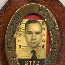 Image of Keuffel & Esser Co., Hoboken, N.J. employee photo identification badge of Arthur E. Miller of Hoboken, n.d., ca. 1940-1950. - Badge, Identification