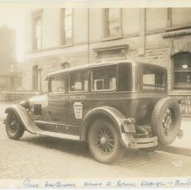 Image of Sepia-tone photo of Hoboken Yellow Cab Co. taxi parked outside Hoboken Police Headquarters, Newark St., between Washington & Bloomfield Sts., Hoboken, March 11, 1933. - Print, Photographic