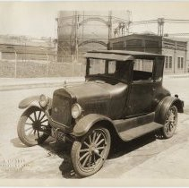 Image of Sepia-tone photos, 2, of automobile parked on Clinton St. between 12th & 13th Sts., Hoboken, n.d., probably 1927 (license plate date.)  - Print, Photographic